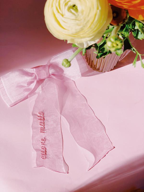 fiocco rosa con scritta cuore matto